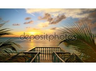 Фотообои «Вид из террасы красивый закат на пляже»