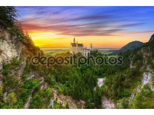 Фотообои «Neuschwanstein Castle in the Bavarian Alps at sunset»