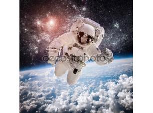 Фотообои «Астронавт на фоне Земли»