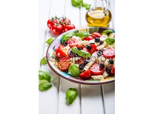 Фотообои «Caprese. Caprese salad. Italian salad. Mediterranean salad. Italian cuisine. Mediterranean cuisine. Tomato mozzarella basil leaves black olives and olive oil on wooden table.»