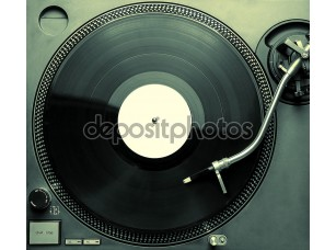 Фотообои «Top view of old fashioned turntable playing a track»