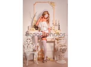 Фотообои «Девочка в белой вуалью и маски в нижнем белье»