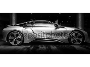 Фотообои «Берлин - 28 ноября 2014: демонстрационный зал. bmw i8, сначала введенная как видение понятия BMW эффективная динамика, является гибридным спортивным автомобилем программного расширения, разработанным BMW. черный и белый.»