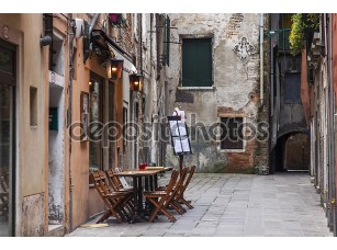 Фотообои «VENICE, ITALY on MAY 3, 2015. Typical city street. Old houses and small outside cafe, look in the cloudy spring morning»