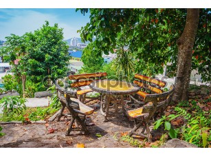 Фотообои «Wooden table and chairs in the garden on the terrace»